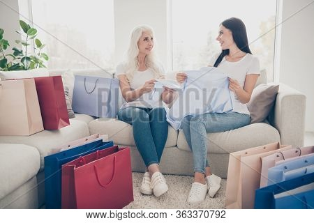 Portrait Of Two Nice Attractive Lovely Charming Pretty Cheerful Cheery Women Opening Bags New Collec