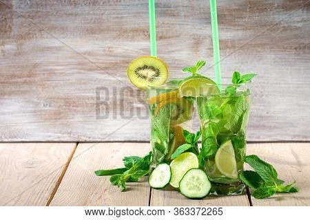 Two Refreshing Summer Cocktails With Lime And Mint, Kiwi And Cucumber