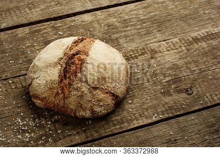 Freshly Baked Traditional Bread On Rustic Wooden Background