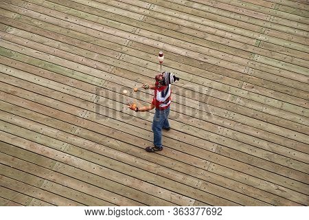 Quebec City, Canada September 23, 2018: A Street Performer Juggling With Balls While High Up In Terr