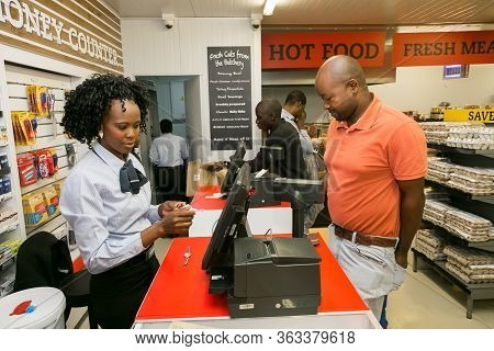 Soweto, South Africa - February 15, 2017: African Cashier And Customer At Checkout At Local Pick N P