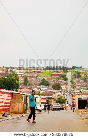 African People Walking Down A Main Road In Alexandra Township, A Formal And Informal Settlement