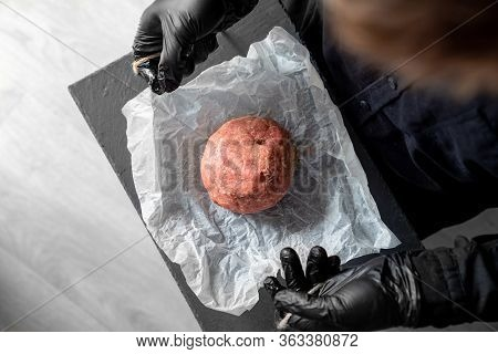 The Minced Meat On The Cooking Paper And Stone Tray In The Hands Of A Man With Black Gloves. Prefabr