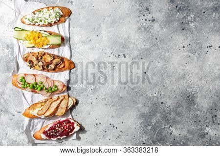 Assorted Italian Appetizer Bruschetta Or Tapas Set With Different Savory And Sweet Topping On Gray C