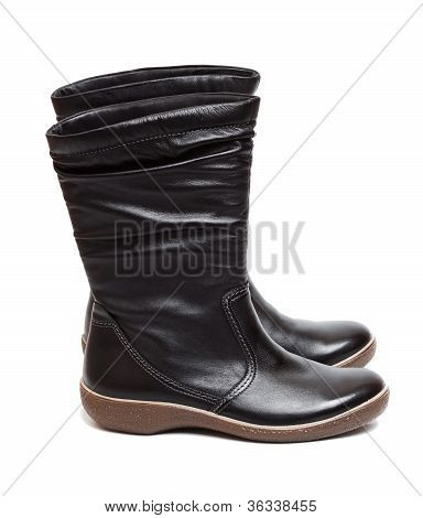Female black boots isolated on the white