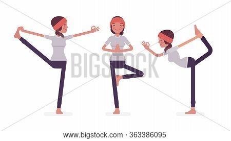 Woman In Yogi Sports Wear Practicing Yoga, Utthita Hasta Padangustasana, Extended Hand To Big Toe Ex