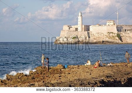 Havana, Cuba - November 11, 2007: Fishermen Hoping For A Catch In Havana Bay, Cuba On A Sunny Evenin