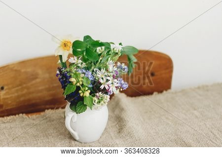 Spring Wildflowers In Vintage Cup On Rustic Wooden Table. Blooming Colorful Flowers Of Ajuga, Forget
