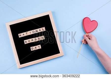 International Nurses Day, May 6. Blackboard With Text National Nurses Day And Cookies Shape Heart In