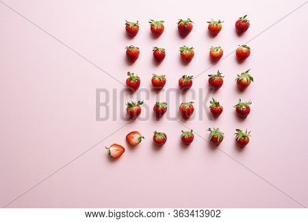 Top View With Strawberries Aligned Symmetrically On A Pink Background. Fresh Organic Strawberries Wi
