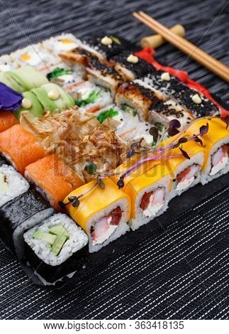 Sushi Roll Japanese Food In Restaurant. Different Types Of Sushi Roll Set With Salmon, Vegetables, F