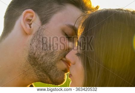 Kissing Couple In Love. Romantic Date. Sensual Kiss Of Two Lovers. People In Relationship Relax Toge