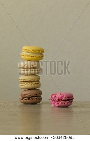 Colorful Macarons. Sweet French Cakes. A Bite Take From One.