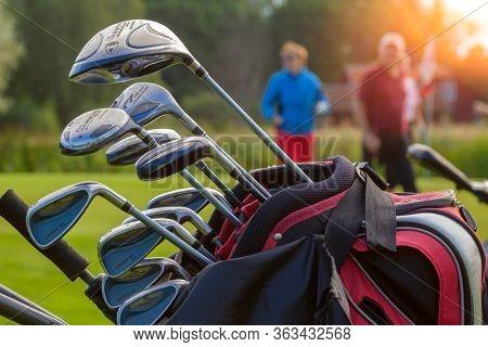 STOCKHOLM, SEPT- 06, 2009: Set of golf clubs in bag and golfplayer in background in Sweden