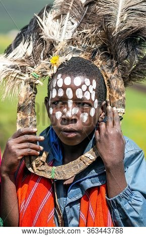 Africa, Kenya, May, 08, 2016 - African Children With Ostrich Feather Headdress And Painted Of Face A