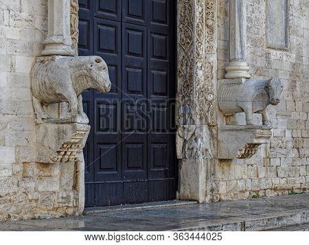 Bulls Guarding The Entrance To The Church Of St. Nicholas.