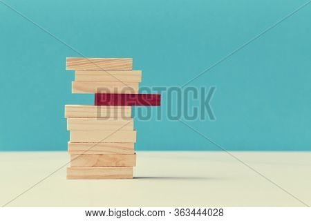 Pile Of Wooden Blocks With One Red Plank. Uniqueness And Originality. Think Outside Box. Not Like Ev