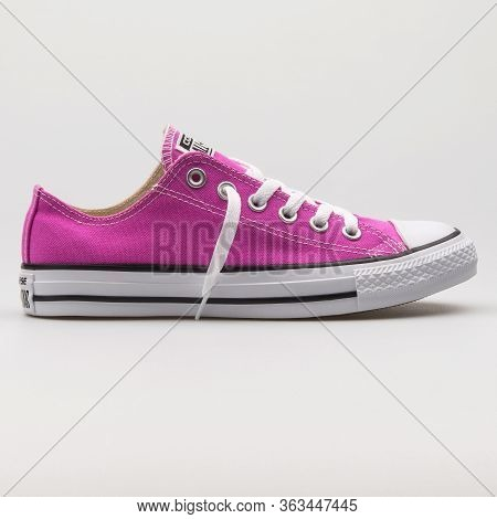 Vienna, Austria - February 19, 2018: Converse Chuck Taylor All Star Ox Magenta And White Sneaker On