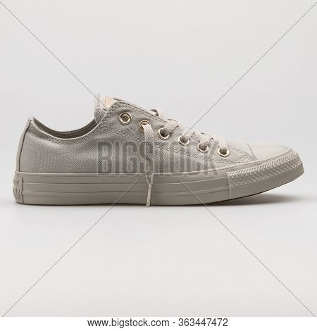 Vienna, Austria - February 19, 2018: Converse Chuck Taylor All Star Ox Grey And Gold Sneaker On Whit