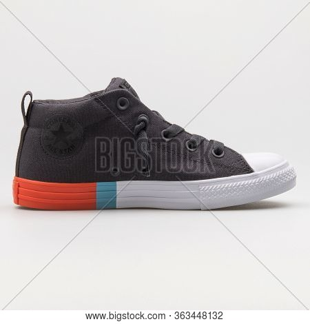 Vienna, Austria - February 19, 2018: Converse Chuck Taylor All Star Street Mid Black Sneaker On Whit