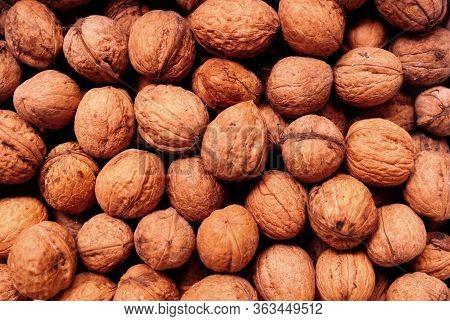 Abstract Walnuts Pattern. Natural Walnuts Background. Natural Food Nuts Walnuts