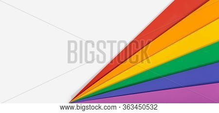Rainbow Flag Banner Background With Copy Space. Gay Pride Flag Or Lgbtq Pride Flag. Photo Of A Group