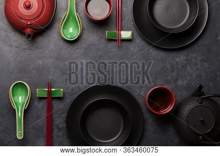 Japanese tea and tableware on stone table. Asian food concept. Top view flat lay with copy space
