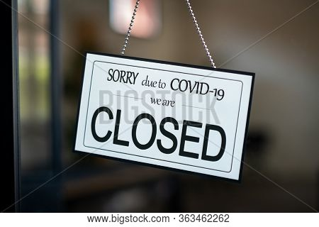 Shop closed due to Covid-19 outbreak lockdown. Temporarily closed sign for coronavirus in a small business activity due to quarantine measures in public places and restaurant. We are closed sign board