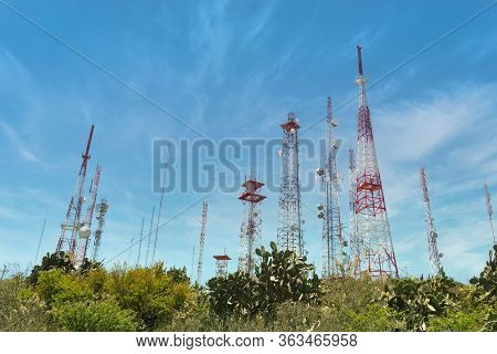 Group Of Telecommunication Antennas Sunny Day, Top Of Hill