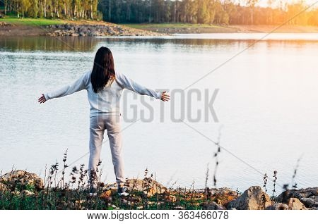 Young Girl Enjoying Freedom In The River