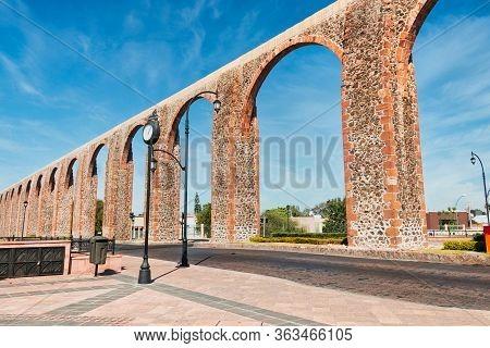 Stone Orange Aqueduct At Queretaro Downtown, Plaza, Mexico