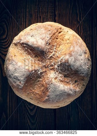 Homebaked Bread. Top View Of Wheat Bread On A Wooden Background. Homemade Baking. Toned Image.