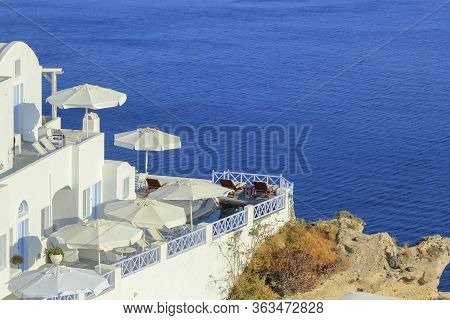 View From A Balcony Oia Village In The Caldera By Day, Greece