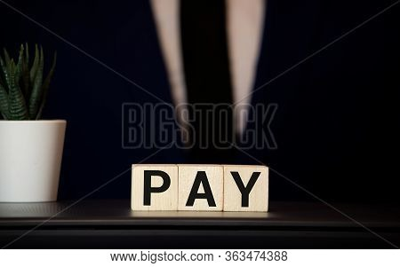 Wooden Blocks With The Word Payroll, Money And A Forklift. Payroll Is The Sum Total Of All Compensat