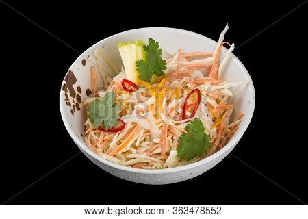 Vitamin Salad From Cabbage And Apples. Served In A Plate. Isolated On A Black Background.