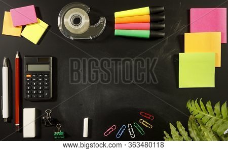 School Stationary Supplies On Black Chalkboard Background With Copy Space Ready For Graphic Design,