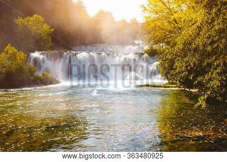 Summer view of Skradinski buk most popular waterfall in Krka National Park. Location Sibenik city, Skradin resort (Lozovac), Croatia, Europe. Famous touristic place. Discover the beauty of earth.