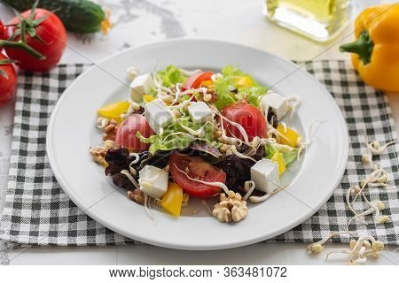 Fresh Spring Salad Of Vegetables, Feta Cheese And Soybean Sprout. Dressed With Olive Oil. Cook At Ho