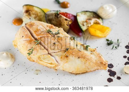 Grilled Chicken Breast Served With Baked Vegetables. Close-up.