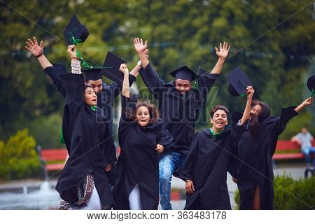 Group Of Happy Indian Students Celebrating The College Graduation, Passing The Final University Exam