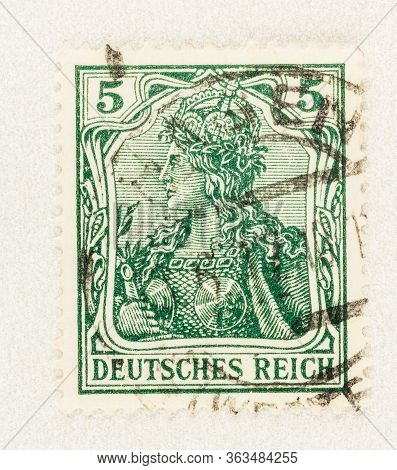 Seattle Washington - April 26, 2020: Green Deutches Reich Stamp  Featuring Germania, The Personifica