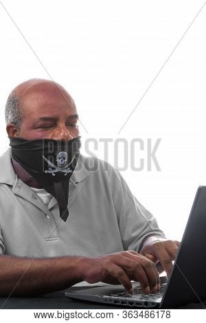 African American Man With Covid 19 Self Made Mask Typing On Laptop Computer. Concept Of Lockdown, Fl