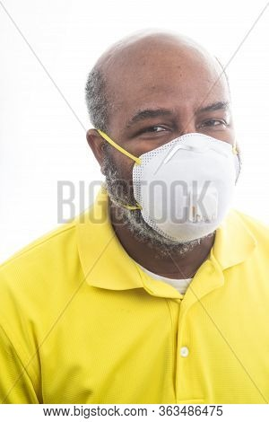 African American Man Wearing Medical Mask To Prevent Covid 19 Virus. Concept Of Lockdown, Flatten Th