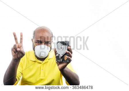 African American Man With Peace Sign And Hard Drive With Medical Mask For Covid 19 Virus  Concept Of
