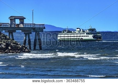 Wooden Pier Washington State Ferry Olympic Snow Mountains Edmonds Washington.  Ferry Leavin Ferry Po