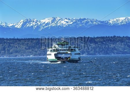 Washington State Ferry Olympic Snow Mountains Edmonds Washington.  Ferry Arriving At Ferry Port On P
