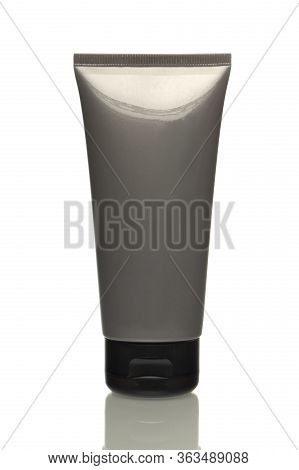Grey Tube With Cream On A White Background, Isolated Object, Space For Text. Template For The Design
