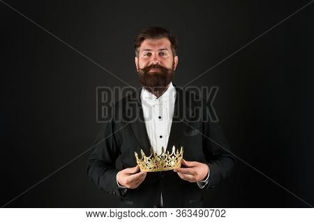 Now Come And Make It Worth. Crown In Hands. Handsome Man Give Crown Black Background. Getting Reward