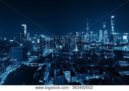 Shanghai Pudong aerial night view from above with city skyline and skyscrapers in China.