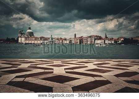 City skyline of Venice and ground pattern viewed from waterfront in Italy.